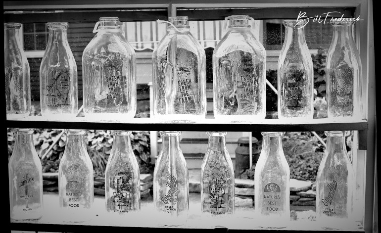 milk bottles with sign