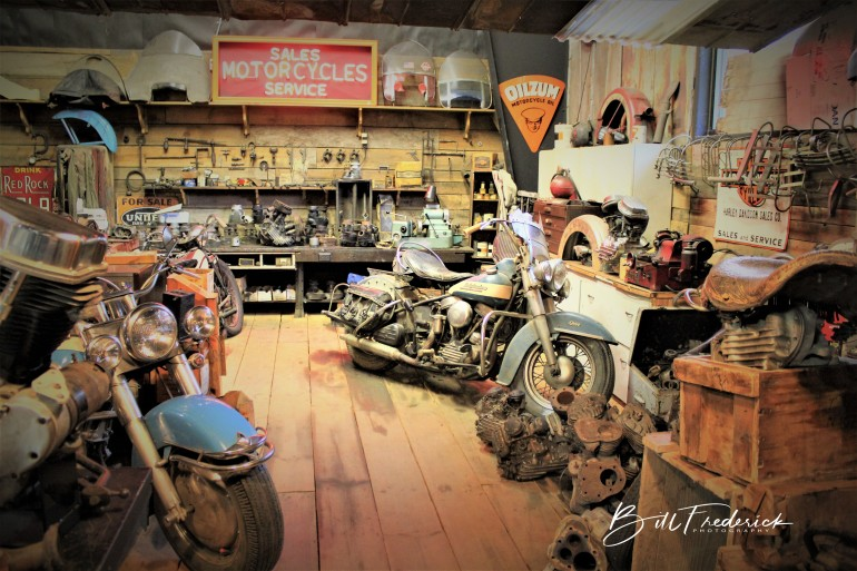 a antique harley shop with sign