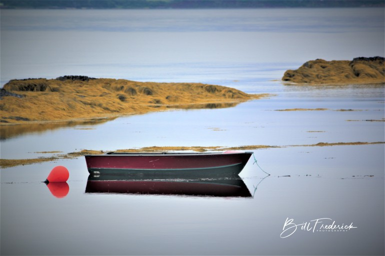 a boat in nova scotia with sign