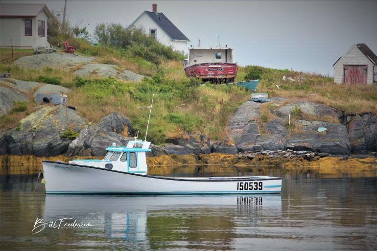 a canadian lobster boat with sign
