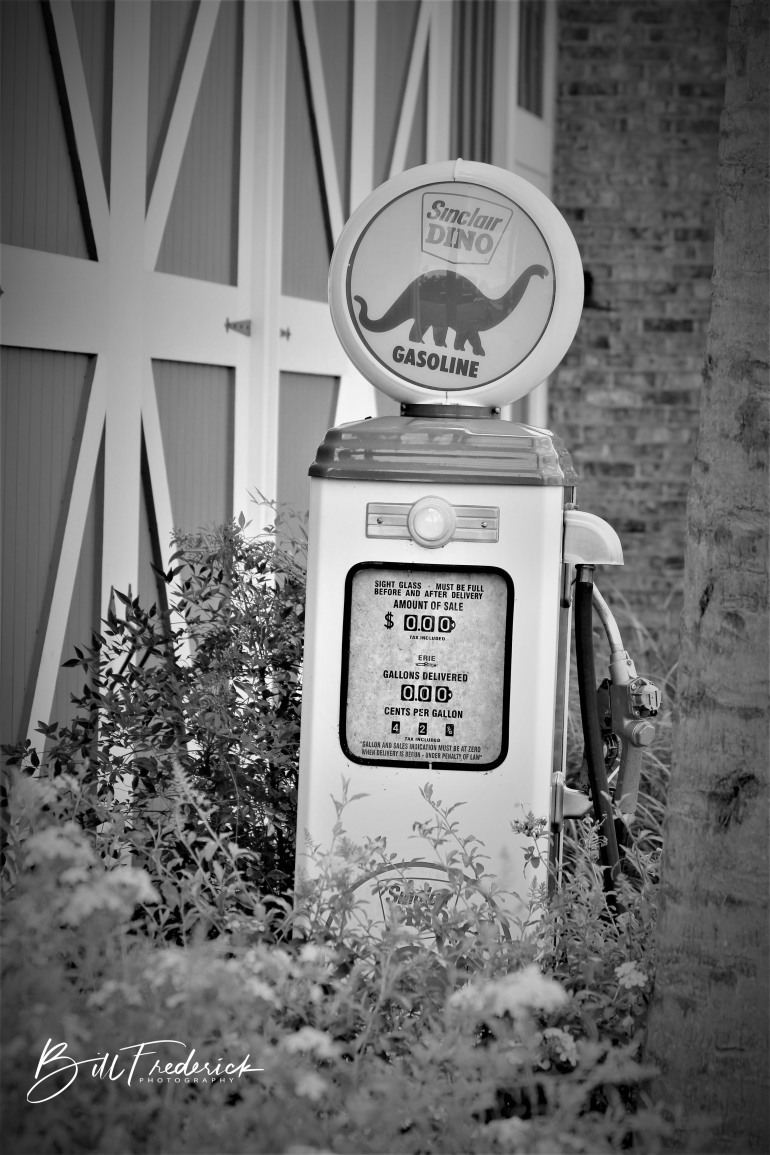 a gas pump with sign