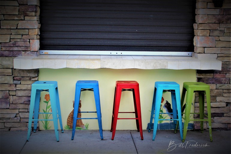 a barstools with sign