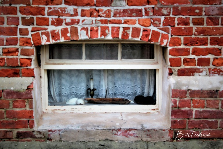 a brick window with sign