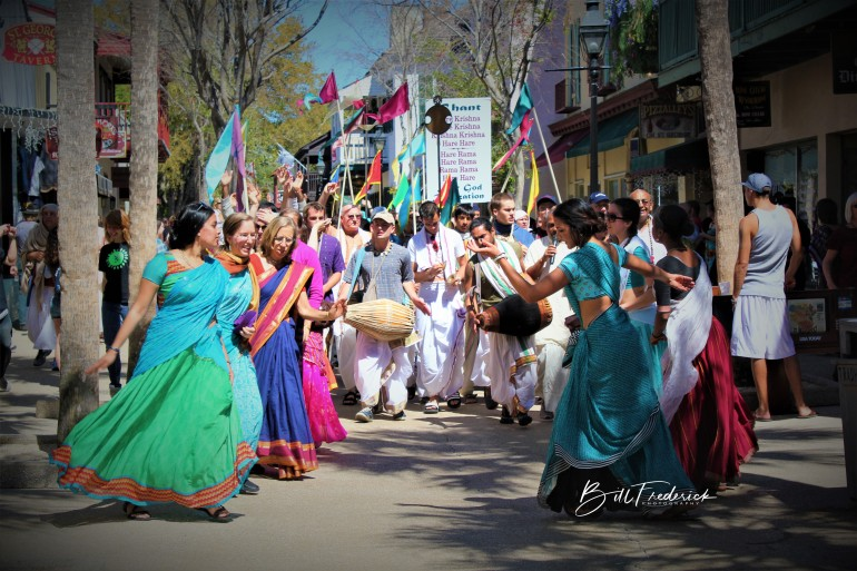 a dancing krishnas with sign