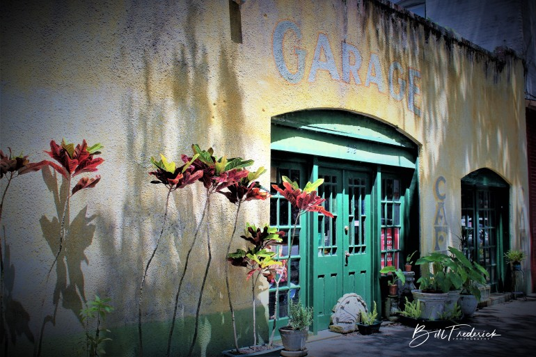 a micanopy garage with sign