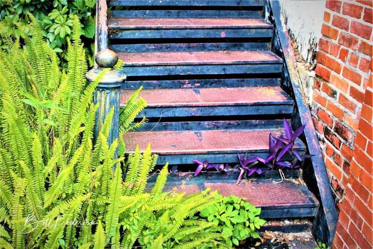 a iron stairs with sign